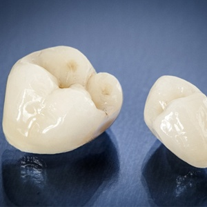 picture of two dental crowns against a black background
