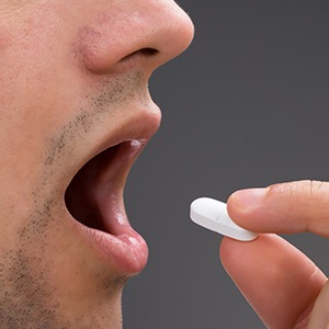 Patient taking oral sedative pill