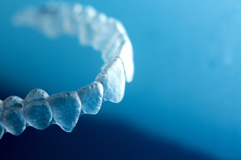 An up-close image of a clear dental aligner